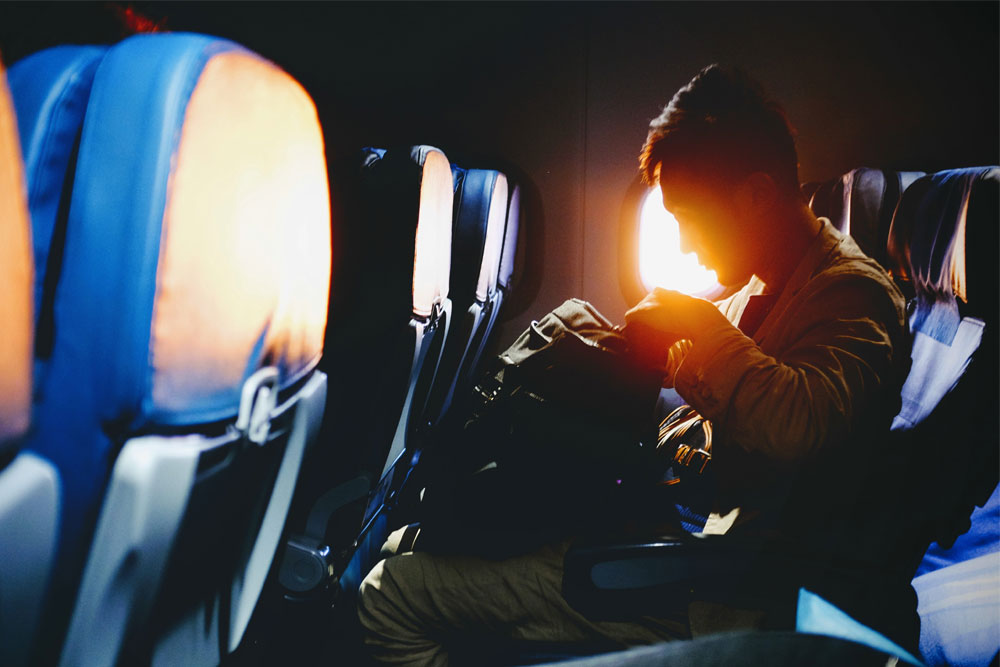 Business Man on Plane at Sunrise