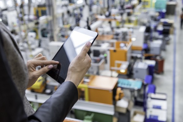 Business Woman Using Tablet at Factory