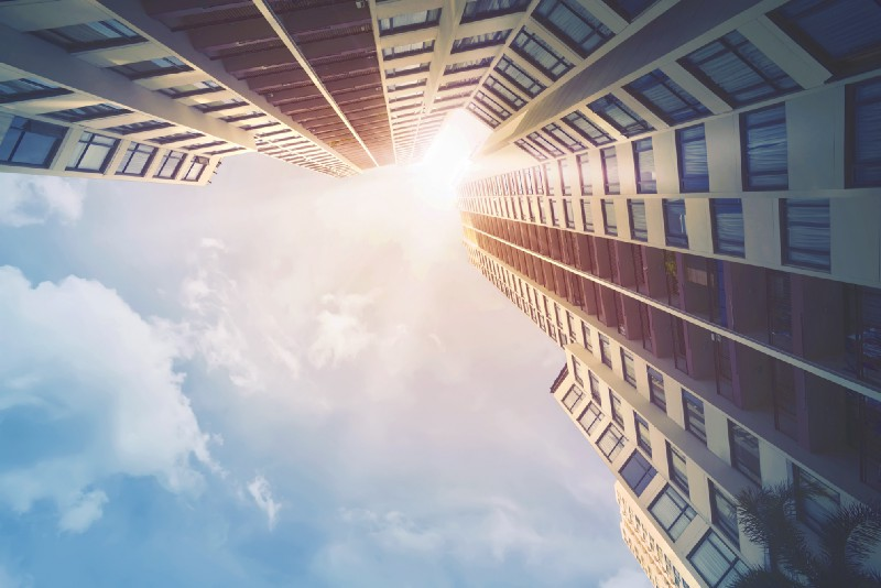 Looking up at Building and Sun