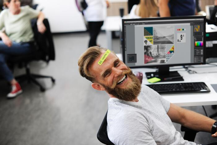 Man with Beard at an Office Computer