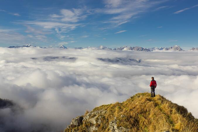 man-standing-on-mountain-against-sky-314703